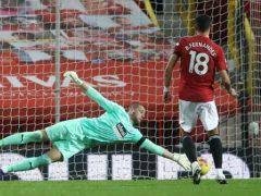 Sam Johnstone saves Bruno Fernandes' first penalty before it was retaken (Martin Rickett/PA)