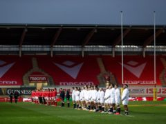 The Wales rugby team lining up in front of an empty stadium ahead of the Autumn Nations Cup game against Llanelli in November (David Davies/PA)
