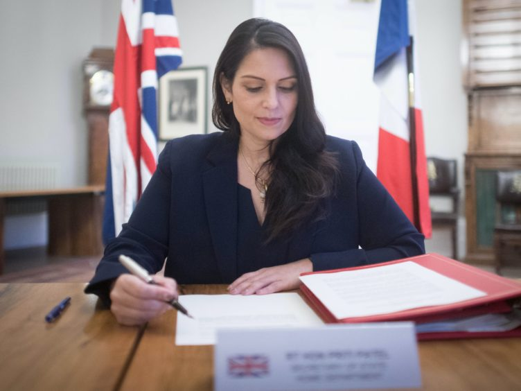 Home Secretary Priti Patel was backed by the Prime Minister after a probe found she had shouted and sworn at staff (Stefan Rousseau/PA)