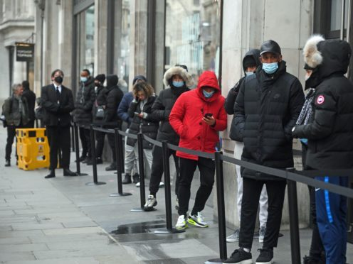 People queueing outside the Nike Town store at Oxford Circus, London (Kirsty O'Connor/PA)