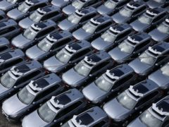 A parking lot full of Uber self-driving Volvos in Pittsburgh. Uber is selling off its autonomous vehicles development arm as it slims down after its revenues were battered by the coronavirus pandemic (Gene J. Puskar/AP)