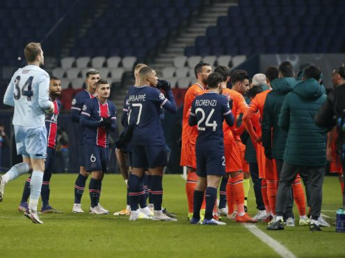 Players of Paris St Germain and Istanbul Basaksehir leave the pitch on Tuesday (Francois Mori/AP)