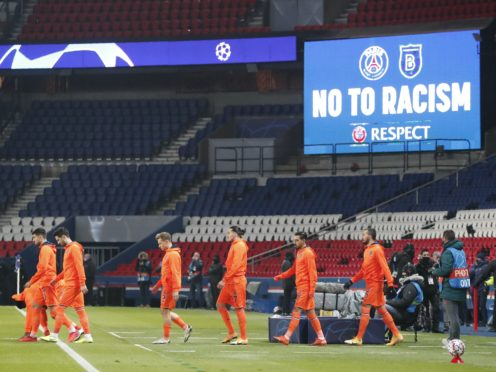 Basaksehir players arrive on the pitch before the start of the Champions League group H soccer match between Paris Saint Germain and Istanbul Basaksehir at the Parc des Princes stadium in Paris, France, Wednesday, Dec. 9, 2020. The match is resuming on Wednesday with a new refereeing team after players from Paris Saint-Germain and Istanbul Basaksehir left the field on Tuesday evening and didn't return when the fourth official — Sebastian Coltescu of Romania — was accused of using a racial term to identify Basaksehir assistant coach Pierre Webo before sending him off for his conduct on the sidelines (Francois Mori/AP)