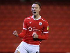 Barnsley's Cauley Woodrow celebrates scoring the winner (Mike Egerton/PA)