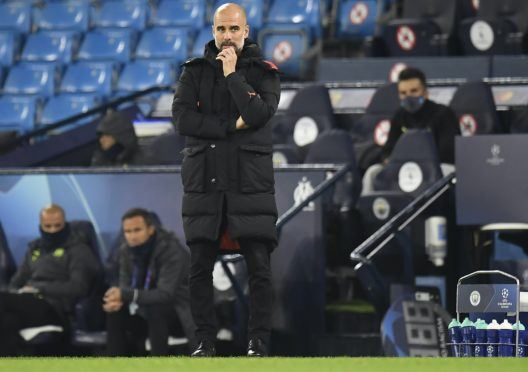 Pep Guardiola is seeking answers to Manchester City's struggles in front of goal (Peter Powell/PA)