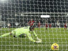 Liverpool's Mohamed Salah scores from the spot at Craven Cottage (Matt Dunham/PA)