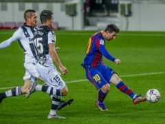 Barcelona's Lionel Messi (right) scores in their 1-0 LaLiga victory over Levante (Joan Monfort/AP)