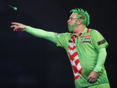 Peter Wright came dressed as the Grinch for his opening match of the World Championships (Kieran Cleeves/PA)