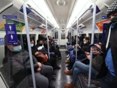 Commuters travelling on a Jubilee Line underground train during the morning rush hour in London (Yui Mok/PA)