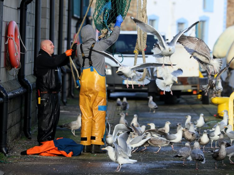 Fishermen at work (Brian Lawless/PA)