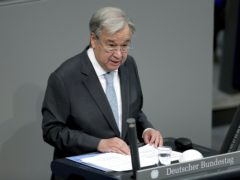 Antonio Guterres heaped praise on German Chancellor Angela Merkel (Michael Sohn/AP)