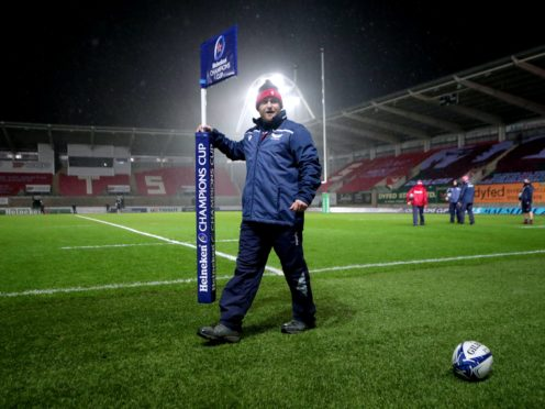 A groundsman removes the corner flag after the Scarlets-Toulon game was called off (David Davies/PA)