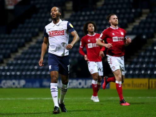 Daniel Johnson, left, celebrates after scoring Preston's winner (Martin Rickett/PA)