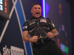 Gerwyn Price, pictured, progressed to the third round with a nervy 3-2 win over fellow Welshman Jamie Lewis (Adam Davy/PA)