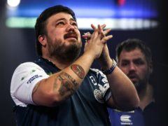 Danny Baggish produced an upset with victory over Adrian Lewis at Alexandra Palace (Kieran Cleeves/PA)
