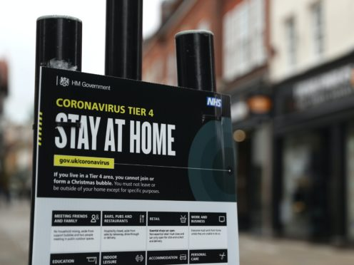 A Government coronavirus Tier 4 sign on the High street in Winchester, Hampshire (Andrew Matthews/PA)