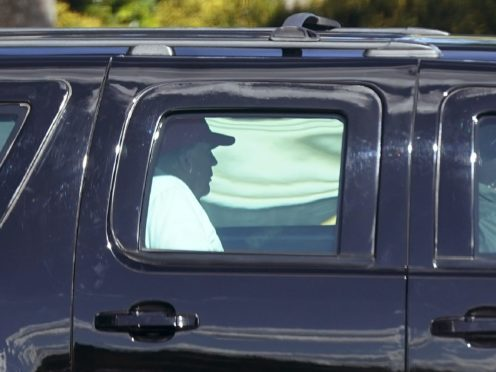 President Donald Trump arriving at his West Palm Beach, Florida golf course on Sunday. He later calmed fears in Washington and across the US by signing the long-negotiated Covid relief bill (Patrick Semansky/AP)