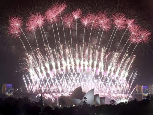 Spectators have been banned from lining Sydney Harbour to watch the New Year's Eve fireworks as a pandemic precaution (Rick Rycroft/AP)