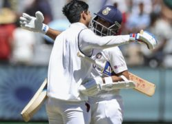 India's Ajinkya Rahane, right, and teammate Shubman Gill celebrate winning the second Test against Australia by eight wickets at the MCG to level the series at 1-1 (Asanka Brendon Ratnayake/AP)