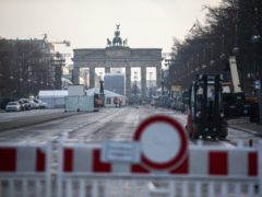 The street leading to the Brandenburg Gate in Berlin, Germany (Christophe Gateau/DPA via AP)