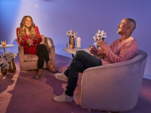 Mariah Carey has recalled writing her festive classic All I Want for Christmas Is You and said the song 'makes me happy' (Apple/PA)