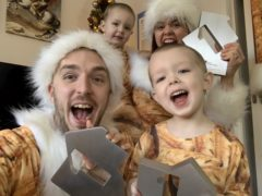 Mark and Roxanne Hoyle with their children, Kobe and Phoenix, celebrating a third Xmas number one (Official Charts Company).