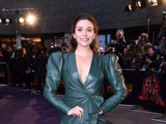 Elizabeth Olsen described growing up with famous sisters as 'weird' (Matt Crossick/PA)