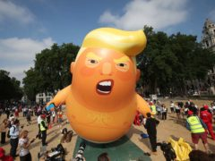 The Baby Trump blimp being raised in Parliament Square (Yui Mok/PA)