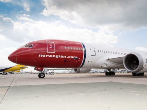 Budget airline Norwegian has axed its long-haul network, leading to the loss of 1,100 pilot and cabin crew jobs based at Gatwick Airport (Norwegian Air Shuttle/PA)