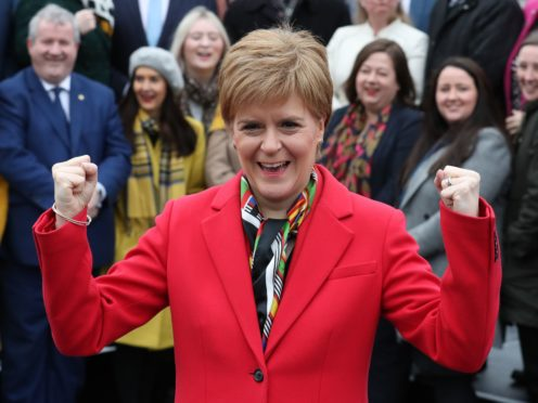 First Minister Nicola Sturgeon's response to the coronavirus pandemic is impressing large numbers of opposition supporters, a poll suggests (Andrew Milligan/PA)