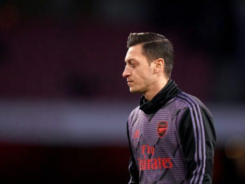 Mesut Ozil last played for Arsenal on March 7 (John Walton/PA)