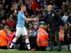 Manchester City manager Pep Guardiola is confident Kevin De Bruyne will commit his long-term future to the club (Martin Rickett/PA)