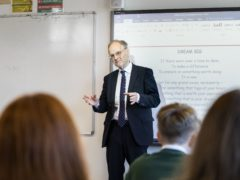Education Minister Peter Weir talking with pupils at St Joseph's Primary School Carryduff, as primary seven year pupils are allowed to return to school in Northern Ireland (Liam McBurney/PA)