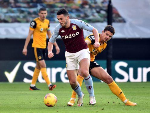 Aston Villa's John McGinn is banned for the visit of Newcastle. (Rui Vieira/PA)
