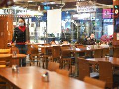 An empty restaurant in the West End of London (Stefan Rousseau/PA)