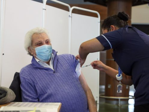 Entertainer Lionel Blair receives the first of two injections with a dose of the Pfizer/BioNtech Covid-19 vaccine (Steve Parsons/PA)