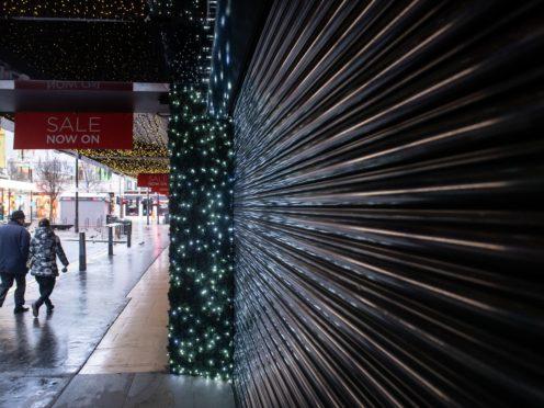 People pass a shuttered shop on Oxford Street, London (Dominic Lipinski/PA)