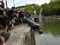 The statue of Edward Colston was dumped in the water during a Black Lives Matter protest in June last year (Ben Birchall/PA)