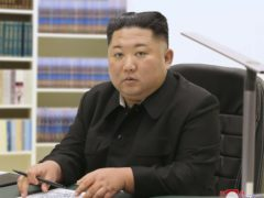 North Korean leader Kim Jong Un has written a New Year card to the public, thanking them for their trust and support 'in the difficult times' and wishing them happiness and good health (Korean Central News Agency/Korea News Service/AP)