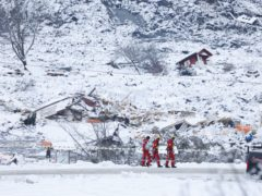 Rescue crews work in the area at Ask (Tor Erik Schroeder/AP)