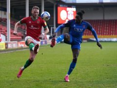 Omari Patrick (right) was on target against Walsall battle for the ball during the Sky Bet League Two match at the Banks's Stadium, Walsall.