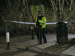 A police officer near the scene in Emmer Green, Reading where a 13-year-old boy died after being stabbed (Jonathan Brady/PA)