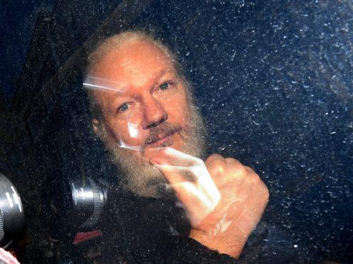 Julian Assange arriving at Westminster Magistrates' Court in 2019 (Victoria Jones/PA)