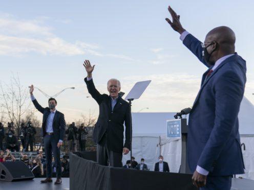 Raphael Warnock, right, Jon Ossoff, left, and Joe Biden (AP/Carolyn Kaster)