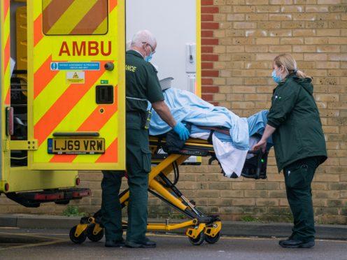 Paramedics transfer a patient from an ambulance into Southend University hospital (PA)
