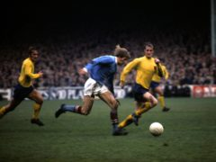 Colin Bell in action for Manchester City (PA)