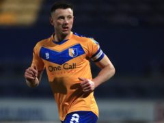 Ollie Clarke has missed Mansfield's last three matches (Mike Egerton/PA)