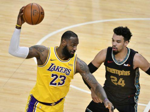 Los Angeles Lakers forward LeBron James handles the ball against Memphis Grizzlies guard Dillon Brooks (Brandon Dill/AP)