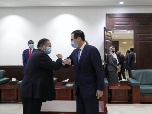 Sudanese Prime Minister Abdullah Hamdok, left, welcomes US Treasury Secretary Stephen Mnuchin to the Cabinet Building, in Khartoum (AP)