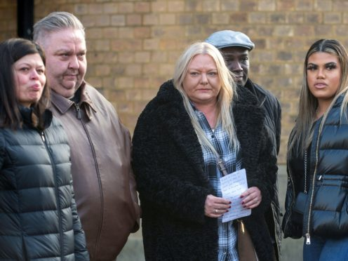 Left to right, Ben Gillham-Rice's mother Susanne Gillham, father Jason Rice with Dom Ansah's mother Tracey, father Dominic and sister Holly outside Luton Crown Court (Joe Giddens(/PA)